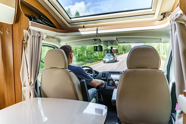 Man driving on a road in the Camper Van. Caravan car Vacation. F